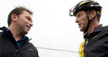 U.S. cyclist Lance Armstrong, right, talks to Astana team director Johan Bruyneel