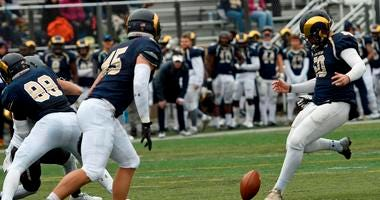 Shepherd University kicker Ruan Venter drop kicks and extra point during a college football game