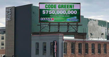 A billboard promotes an estimated $750 million Powerball jackpot in downtown Des Moines, Iowa, Wednesday, March 27, 2019.