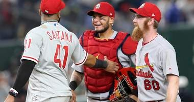 MLB All-Star catcher Yadier Molina, center, of the St. Louis Cardinals celebrates with closer John Brebbia (60) of the St. Louis Cardinals
