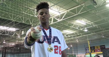 Christian Little wears gold medal and USA jersey from U15 Baseball World Cup.