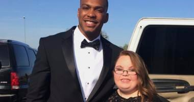 Lindsey Preston, next to NFL player Don Jones at Preston's prom in Moulton, Ala.