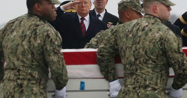 President Trump salutes the coffin of Scott Wirtz