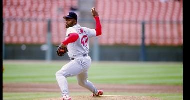 Pitcher Lee Smith of the St. Louis Cardinals prepares to throw the ball during a game against the San Francisco Giants.