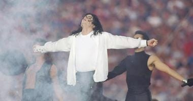 Entertainer Michael Jackson sings at half-time during the Super Bowl X XVII