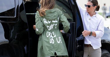 JOINT BASE ANDREWS, MD - JUNE 21: U.S. first lady Melania Trump (C) climbs back into her motorcade after traveling to Texas to visit facilities that house and care for children taken from their parents at the U.S.-Mexico border June 21, 2018