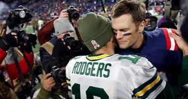 Green Bay Packers quarterback Aaron Rodgers (12) greets New England Patriots quarterback Tom Brady