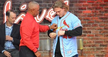 St. Louis Cardinals outfielder Harrison Bader tries on the new powder blue jersey.