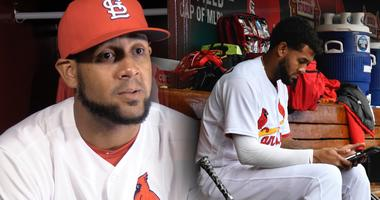 St. Louis Cardinals first baseman Jose Martinez watching video in the dugout.