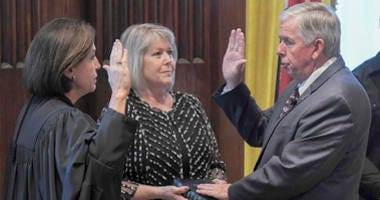 Missouri Supreme Court Judge Mary Russell administers the oath to Lt. Gov. Mike Parson, becoming Missouri's 57th governor while his wife Teresa, looks on in Jefferson City, Missouri on June 1, 2018.
