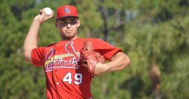 Cardinals pitcher Jordan Hicks throwing at spring training.