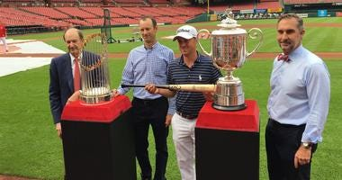 Justin Thomas poses with Cardinals leadership at Busch Stadium.