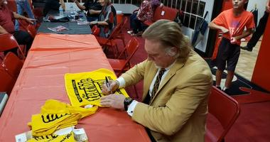 Kevin Greene signs some Pittsburgh Steelers Terrible Towels in Granite City, Ill. on August 30, 2019