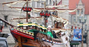 A young girl rides in a replica of the Mayflower during the Thanksgiving Day Parade in St. Louis on Thursday, November 28, 2019.