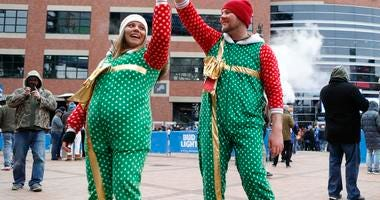 Kaleb and Carly dance in festive onesies before the game between the Detroit Lions and the Chicago Bears