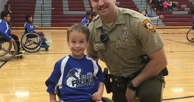 Saint Louis Rolling Rams player with a St. Louis County Police Officer.