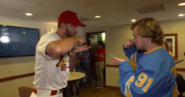 Adam Wainwright shares the Cardinals salsa with Vladimir Tarasenko and the Blues.