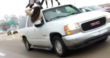 People caught on video dancing on their car on I-64 in St. Louis.