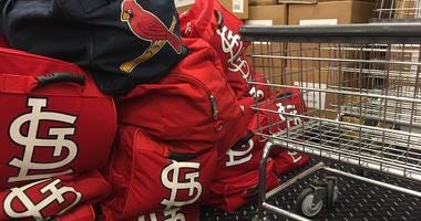 Cardinals gear is packed in Busch Stadium to be sent to Jupiter, Fla for spring training.