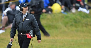 Jordan Spieth talks with David Feherty during the second round of The 146th Open Championship