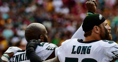 Philadelphia Eagles defensive end Chris Long (56) stands with strong safety Malcolm Jenkins