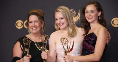 From left, Ann Dowd , Elizabeth Moss and Alexis Bledel pose with their awards for Outstanding Drama Series for 'The Handmaid's Tale' in the trophy room during the 69th Emmy Awards at the Microsoft Theater.