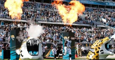 Jacksonville Jaguars players enter the field before a football game
