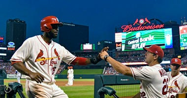 St. Louis Cardinals right fielder Dexter Fowler (25) is congratulated by manager Mike Matheny