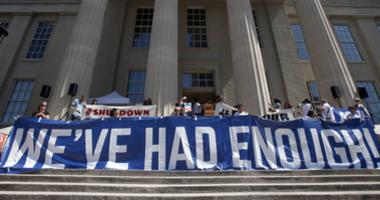 Members of the 'Families Belong Together' rally left Metro Hall and marched to the Immigration and Customs Enforcement facility in Louisville, Ky.