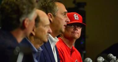 St. Louis Cardinals interim manager Mike Shildt (83) looks on as president of baseball operations John Mozeliak