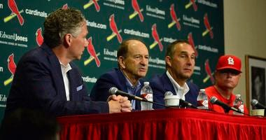 St. Louis Cardinals interim manager Mike Shildt (83) and president of baseball operations John Mozeliak and chairman Bill DeWitt Jr and general manager Mike Girsch talk during a press conference.