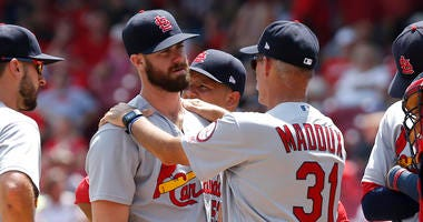 St. Louis Cardinals pitching coach Mike Maddux (31) talks with relief pitcher John Gant