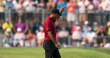 Tiger Woods acknowledges the crowd on the 18th hole during the final round of the PGA Championship golf tournament at Bellerive Country Club.