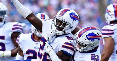 Buffalo Bills defensive back Vontae Davis (22) and defensive back Micah Hyde (23) celebrate