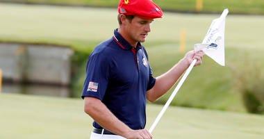 United States golfer Bryson Dechambeau pulls the flag
