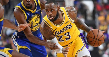 Los Angeles Lakers forward LeBron James (23) dribbles during the first half against the Golden State Warriors