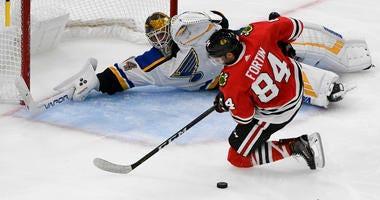 St. Louis Blues goaltender Jake Allen (34) defends against Chicago Blackhawks left wing Alexandre Fortin