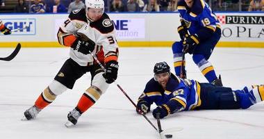 Anaheim Ducks center Sam Steel (34) handles the puck as St. Louis Blues defenseman Alex Pietrangelo