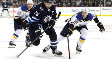 Winnipeg Jets right wing Blake Wheeler (26) skates with the puck as St. Louis Blues defenseman Jay Bouwmeester