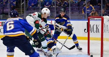 Minnesota Wild center Joel Eriksson Ek (14) shoots and scores against St. Louis Blues goaltender Chad Johnson
