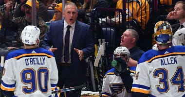 St. Louis Blues interim head coach Craig Berube talks with his players