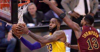 Los Angeles Lakers forward LeBron James (23) drives against Cleveland Cavaliers center Tristan Thompson