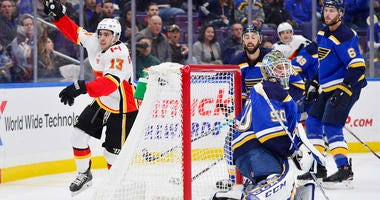 Calgary Flames left wing Johnny Gaudreau (13) celebrates after scoring against St. Louis Blues goaltender Jordan Binnington