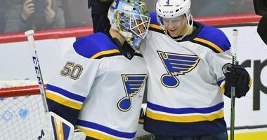 St. Louis Blues goaltender Jordan Binnington (50) celebrates with defenseman Carl Gunnarsson