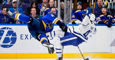 Toronto Maple Leafs center Nazem Kadri (43) is checked by St. Louis Blues defenseman Vince Dunn (29) during the first period at Enterprise Center.