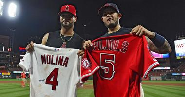 Albert Pujols concludes St. Louis return with 2 hits, Molina jersey swap