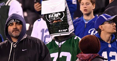 A New York Jets fan reacts in the fourth quarter
