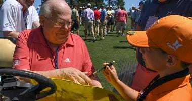 CBS Broadcaster Verne Lundquist autographs a Masters flag