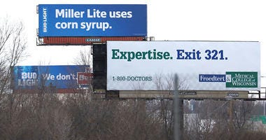 Bud Light billboard claiming Miller Lite uses corn syrup