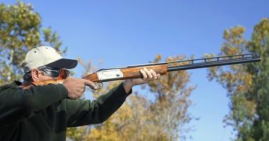Bird hunting or shooting skeet.